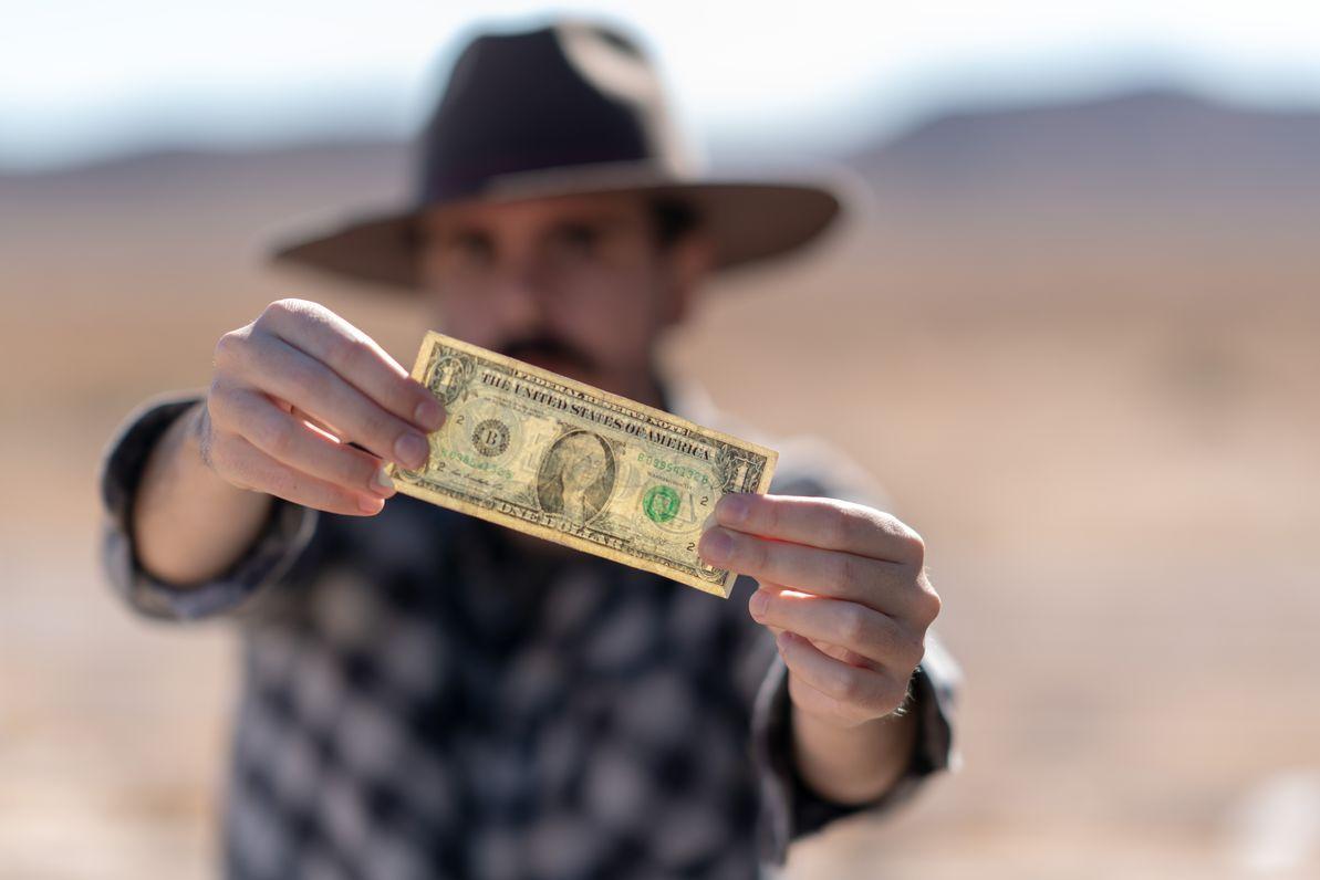 sugar daddy holding a money